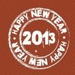 На коричневом фоне белый штамп Happy New Year 2013