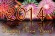 Яркие отблески новогоднего салюта и надпись с Новым 2014 годом