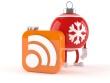 Новогодняя RSS: Классическая квадратная иконка RSS. За ней на тонких ножках стоит красный ёлочный шар с белой снежинкой