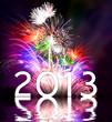 Много разноцветных, ярких фейерверков, а на фоне их белая надпись 2013.