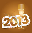 Коричневый фон, бокал шампанского и коричневая надпись 2013 в белом обрамлении.