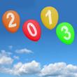 Голубое небо, белые облачка и летящие в высь разноцветные шарики с надписью 2013.