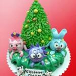 Детский новогодний торт Смешарики. Нюша, Ёжик и Крош сидят под ёлочкой