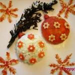 Еловая веточка украшенная шарами из сырного салата и моркови